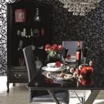 Camera decorata in alb si negru cu elemente de decor rosu